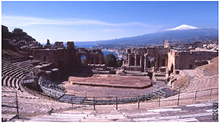 Taormina's Greco-Roman amphitheatre with Etna and the Ionian Sea in the background.